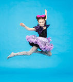 Flight of little girl in funny carnival costume Royalty Free Stock Photo