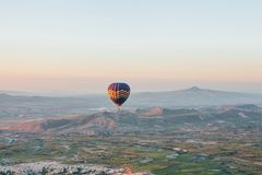 Flight of a lonely balloon in the sky in the morning at sunrise or in the evening at sunset. Travel by air or adventure.  stock images