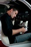 Flight Manual. A pilot checking the flight manual before a night flight Stock Image