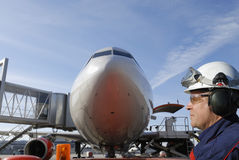 Flight mechanic and airplane Royalty Free Stock Photo