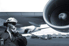 Flight mechanic and airplane Stock Image