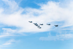 Flight military fighter aircrafts in white clouds Stock Images