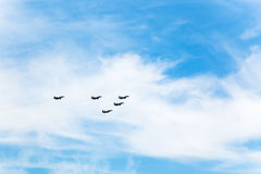 Flight military fighter airplanes in white clouds Royalty Free Stock Photography