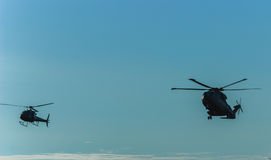 Flight of military helicopters. Military helicopters in the sky Royalty Free Stock Photo