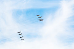 Flight military pursuit aircrafts in white clouds. Flight of military pursuit aircrafts in white clouds in blue sky Stock Images