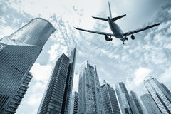 Flight and modern building Royalty Free Stock Image