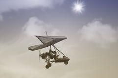Flight of the motor deltaplane. Stock Photo