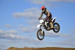 Flight of motorcycle racer MX forward inclined Royalty Free Stock Photo