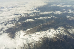 Flight over Alps Stock Images