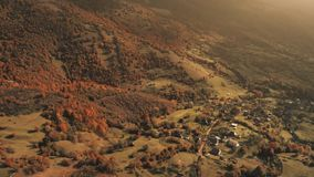 Flight over beautiful village located in canyon stock video footage
