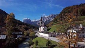 Flight over church in Ramsau, Berchtesgaden, Germany stock video footage
