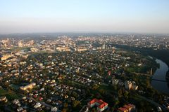 Flight over city. City buildings and streets from sky in a sunset Royalty Free Stock Photo