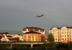 Flight over the city. Landing, flying over the city, the feeling of weightlessness, the city in the sunset Stock Photo