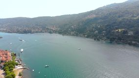 Flight over city on Maggiore lake bank stock footage