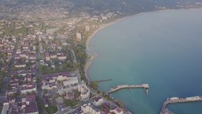 Flight over the city near the sea. Pier for ships.  stock footage