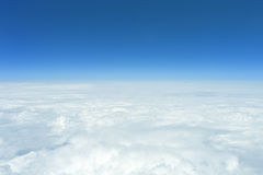 Flight over clouds. An image of a flight over the clouds Royalty Free Stock Photo