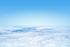 Flight over the clouds background Stock Image