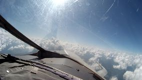 Flight over clouds view from cockpit plane. stock video
