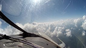 Flight over clouds view from cockpit plane. stock footage