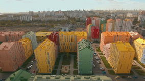 Flight over cozy comfortable colored houses in a European city 4K UHD aerial stock video footage
