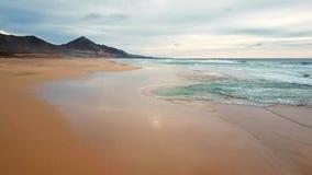 Flight over desert beach on Fuerteventura island, Spain. Aerial view of desert beach Playa de Barlovento, Jandia Peninsula on Fuerteventura, Canary Islands stock video