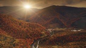 Flight over dramatic autumn sunset landscape stock footage