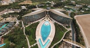 Flight over elite Mriya resort. Swimming pool, tennis courts, helicopter pad stock video footage