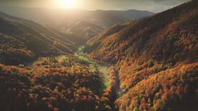 Flight over fantastic autumn mountain landscape