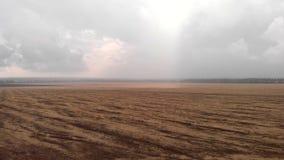 Flight over field n the rain stock footage