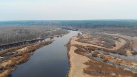 Flying over the river in early spring stock video footage
