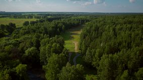 Flight over the forest and recreation areas stock footage