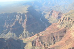 Flight over the Grand Canyon. The Grand Canyon is 277 miles long, up to 18 miles wide. This is very amazing scenery. Me must watching a long time. This canyon Royalty Free Stock Photos