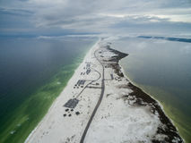Flight over the Gulf of Mexico and Beach in Pensacola with Empty Road Stock Images