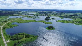 Flight over lakes and meadows land. Flight over blue lakes and green meadows land stock video footage