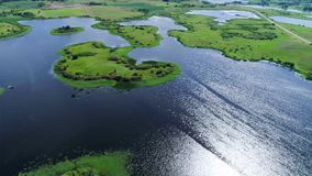 Flight over lakes and meadows land. Flight over blue lakes and green meadows land stock video