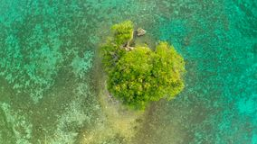 Flight over the lonely little island off the coast of Philippine villages. Anda. royalty free stock photos