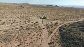 Flight over long highway at monument valley in Utah - Drone Aerial over cars in Arizona. Top view drone footage flying