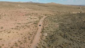Flight over long highway at monument valley in Utah - Drone Aerial over cars in Arizona. Top view drone footage flying stock footage