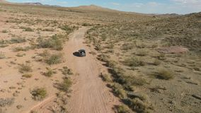Flight over long highway at monument valley in Utah - Drone Aerial over cars in Arizona. Top view drone footage flying stock video footage