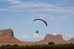 Flight Over Monument Valley. A powered paraglider pilot in flight over Monument Valley Stock Images