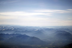 Flight Over Mountains From Window Of Domestic Airline Stock Photography