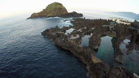 Flight over Natural Lava Pools in Porto Moniz, Madeira stock video footage