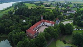 Flight over old castle in green forest stock video