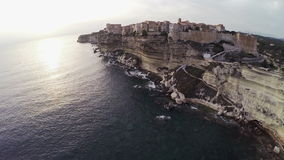 Flight over old city Bonifacio and area at sunset colors. Corsica, France. Aerial view. stock video