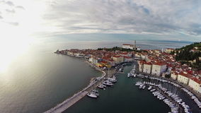 Flight over old city Piran, aerial panoramic view. stock video