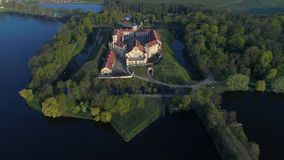 Flight over old Nesvizh castle, may morning. Nesvizh, Belarus aerial video stock video footage