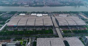 Flight over the Pazhou Exhibition Complex. International exhibition Canton Fair. China Import and Export Fair view from. International exhibition Canton Fair stock video footage