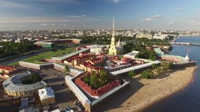 Flight over Peter and Paul fortress. Unique aerial view of St. Petersburg sightseeing from above. Russian legacy. Warm sunny day. 4K footage. Warm sunny day stock video footage