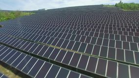 Flight over Photovoltaic solar units stock video footage