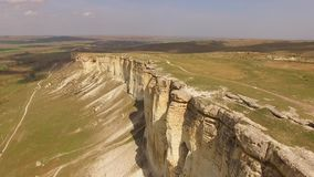 A flight over a plateau with white rocks torn from the ground. bird`s eye view. Aerial view stock footage